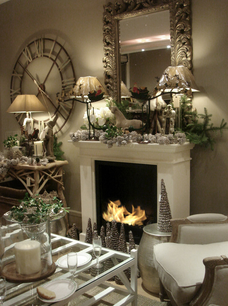 beautiful traditional fireplace with christmas decorations on the mantel