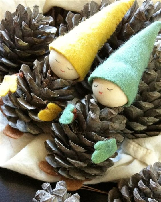 These pine cone gnomes look beautiful on the mantelpiece!