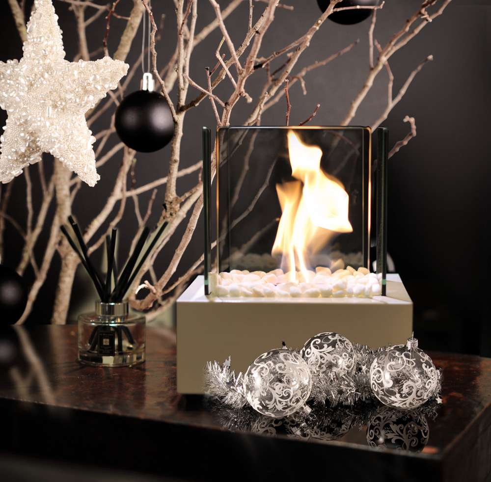 Win a bio ethanol glass cube portable mini burner fireplace.