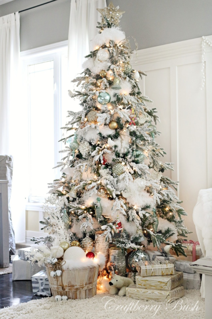 A white Christmas tree can look radiant, glowing with the dazzle of silver and gold baubles.