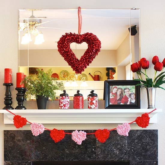 Decorate your fireplace in red, pink, hearts, roses and rose petals for Valentine's day.
